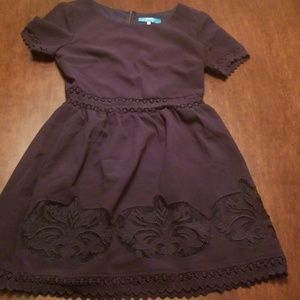 Navy blue mini dess with lace accessory.